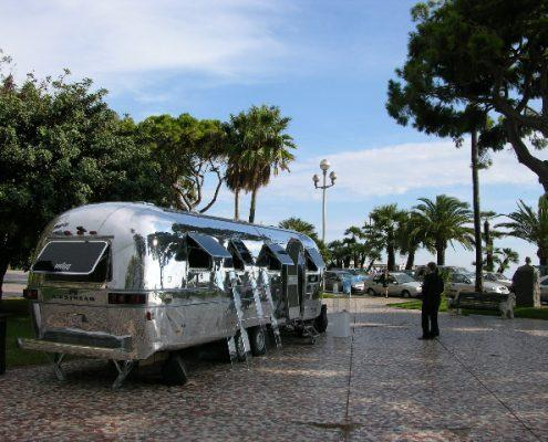Airstream caravan polished on beach front