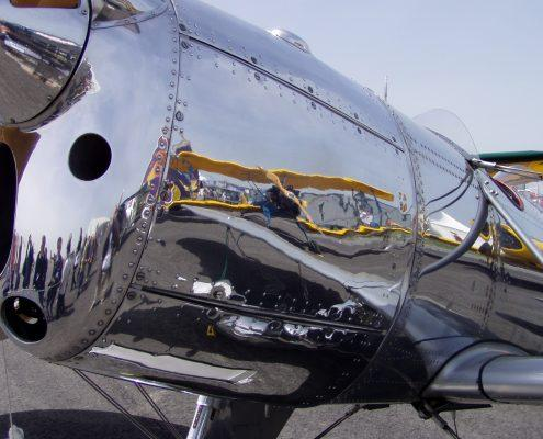 Two seater plane polished metal reflection