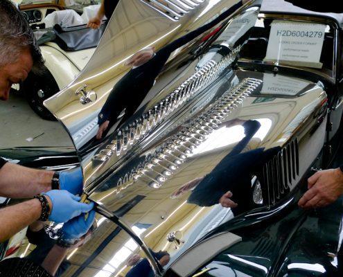 Old car bonnet being polished