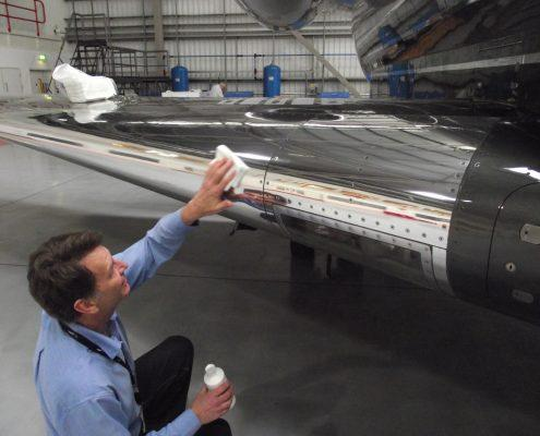 Jet engine being polished with cloth